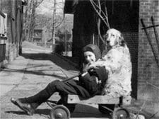 Glen Gould and Nick playing on a wagon