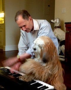 Dog Playing Piano | NYC Dog Trainer Services & Dog Wellness |