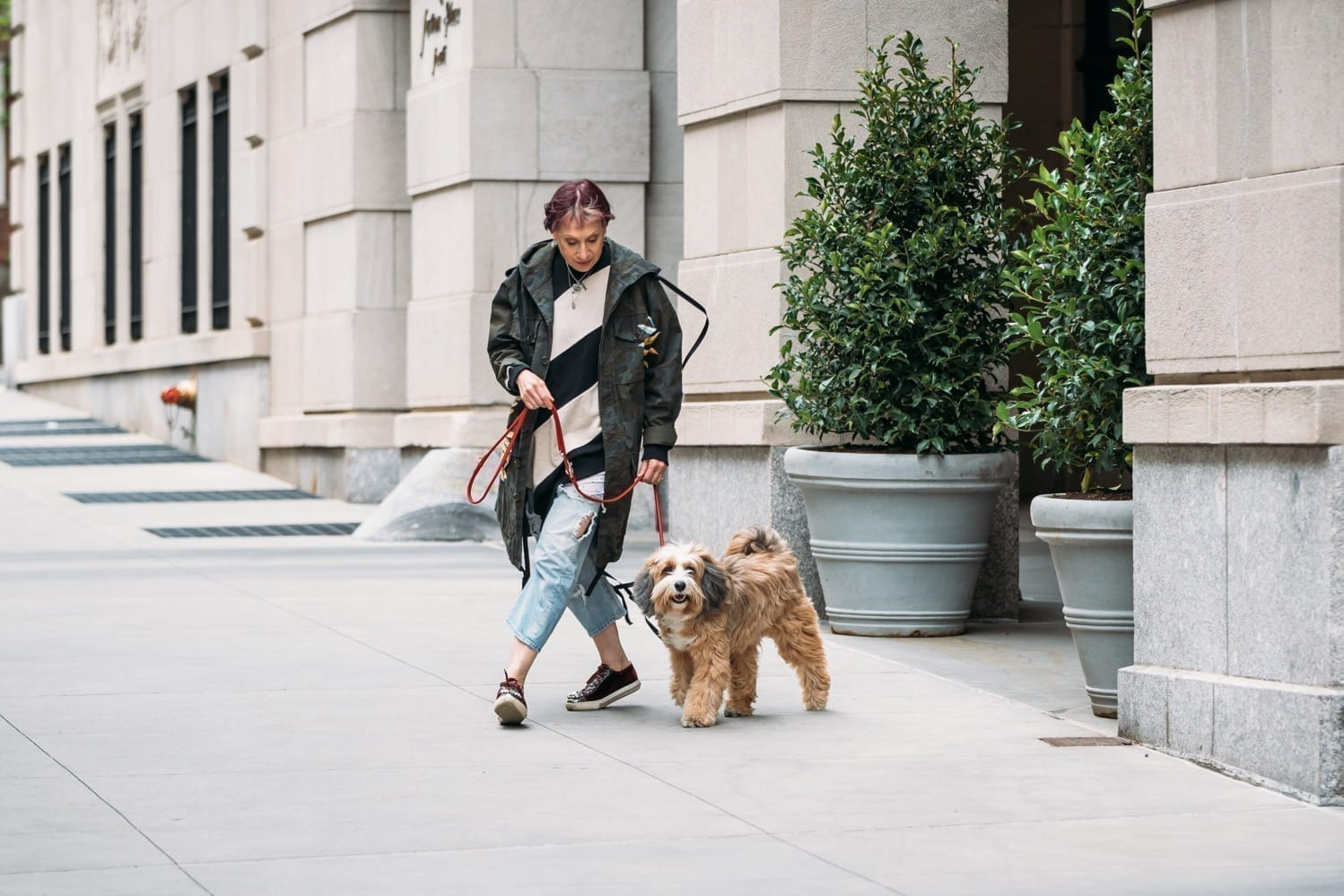 Dog Relations NYC trainer Elisabeth Weiss walking with Buddy
